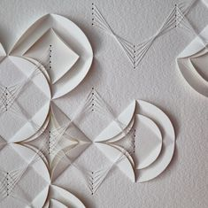 artist liz sofield Twisted Rhythm 2 detail, hand folded and hand stitched on watercolour paper. #origami #paperart #embroidery #handstitched #contemporaryembroidery