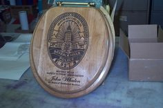 A laser Engraved wood toilet Seat as a retirement present for a Beverly Hills Police Officer using his badge as the logo. Custom Laser Engraving 408-605-3435 / clamkinman@comcast.net