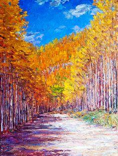 A broad path through an aspen forest in autumn.
