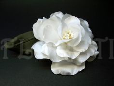 Bridal White Silk Abstract-Impressionist LaLuna Magnolia Handmade Wedding Floral Hair Accessory Pin-up Flower.    LaLuna abstract-impressionist Magnolia bloom is great for any occasion. Custom-made of white color satin with pearl center and comes with an olive color leaf. Wear it to embellish your dress, hat, or simply pinup in your hair.