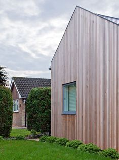 A 1960's bungalow in Cambridgeshire is hidden behind a Siberian larch-clad extension with a row of gabled roofs.