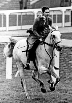 A young Queen Elizabeth at full gallop.