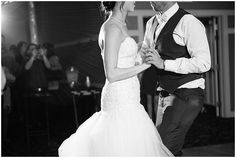 Black and white photo of the bride and groom sharing their first dance
