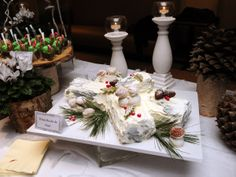 ~ White Bûche de Noël ~ On the Winter Wonderland dessert table at a recent office holiday event.  Thin layers of vanilla sponge filled with vanilla mousse and topped with white buttercream. Each cake is textured to look like a real log and decorated with Meringue mushrooms, holly and berries.