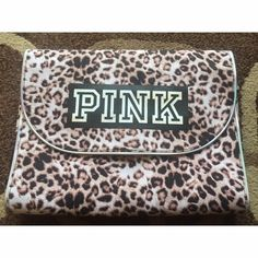 """PINK Victoria's Secret Leopard Print Organizer Can be used for travel or hung in your room • Gorgeous print, in excellent condition (third photo shows glare because it was taken outside) • Only mark on entire thing was the small dash on the """"I"""" but it's smaller than a dime • Dimensions: (when closed): 12 inches across & 9.25 inches tall. (When open): 24 inches tall & 12 inches wide• NO TRADES NO PAYPAL • PINK Victoria's Secret Bags Travel Bags"""