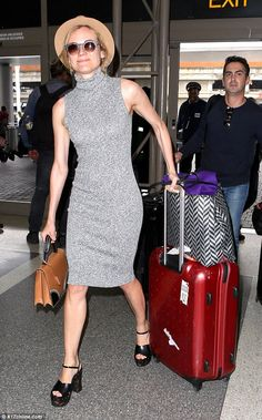 Diane Kruger rocks grey dress and chic fedora as she leaves for Cannes #dailymail
