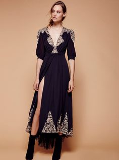Antique Lace Wrap Gown | Gorgeous silk gown inspired by days past with delicate lace accents and an elegant puffed shape at the sleeves by Free People