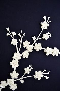 This sweet pretty little blossom branch comes as a set of two pieces(photo 2), which makes them extremely versatile, you can arrange them into any position! In length they measure approximately 38cm(15in) and 35.5cm(14in). Photo 4 shows two sets used together. You can buy them ready made or as a kit for you to make yourself. You can see them used to make a wedding backdrop here: https://www.etsy.com/uk/listing/180877932/beautiful-custom-wedding-backdrop    These flowers are cut from a lovely…