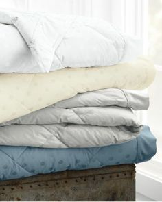 Down Blanket - www.blanketsnmore.com/blankets---throws-contemporary.html - Our new collection of vivacious blankets are here. Offered in a variety of patterns and colors to suit any personal style. Thses generously sized blankets are ideal year round. The warm plush down is perfect for cold evenings and the smooth, shiny material is cool and comfortable on the skin.