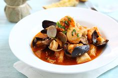 Cioppino.3/4 cup butter. melt. Add 2 med  onion, chopped; 3 cloves garlic, minced; 1 bunch fresh parsley leaves, minced. Saute. Add 2 (14.5-ounce) cans plum tomatoes undrained and cut up; 2 (8-ounce) bottles clam juice; 2 bay leaves; 1 tablespoon dried basil leaves; 1/2 teaspoon dried thyme leaves; 1/2 teaspoon dried oregano leaves 1 1/2 cups dry red or white wine (whichever you prefer). Simmer sauce 20 minutes. Refrigerate up to 2 days. Bring to simmer, add seafood til don.