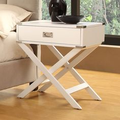 Campaign style x-base side table, $147
