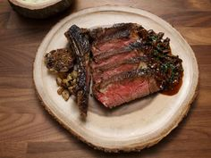 Ribeye with Mashed Potatoes and Mushroom Sauce Recipe | Anne Burrell | Food Network Steak And Mushrooms, Creamed Mushrooms, Stuffed Mushrooms, Pickled Hot Peppers, Worst Cooks In America, Strip Steak, Fresh Chives, Kitchens