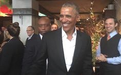 Hundreds cheer as a relaxed Barack Obama surfaces in Manhattan