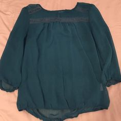 Beautiful teal blouse Beautiful teal blouse with a little bit of lace on top !!! Size S only worn a few times still in great condition!!!! Lily star Tops Blouses