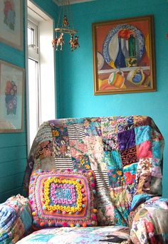 Chair draped with a colorful quilt.