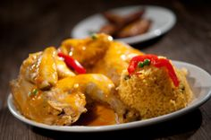 Arroz con Pollo - Havana style chicken with yellow rice, garnished with green peas and red pimentos accompanied by sweet plantains or beans.