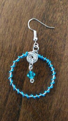 Ciondolo/orecchini circolari con spirale #orecchini #ciondoli #celeste #azzurro #wire #spiral #spirali #cerchi #circles #handmade #jewelry #lightblue
