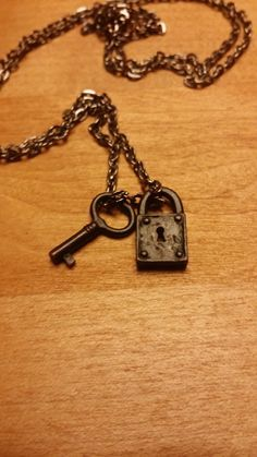Vintage style separate charms lock and key necklace. Made from solid antiqued brass. Black in color. Comes with black silver chain.