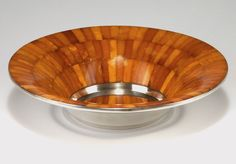 Königsberg factory. Art Deco Bowl, 1930s. Silver and amber. Marked: 835 S, eagle, SBM, hammers, Angefertigt in den Werkstätten der Staatlichen Bernsteinmanufaktur Königsberg/Pr. H. 5.8 cm, D. 25 cm.  |  SOLD 5,000 EUR, 2015