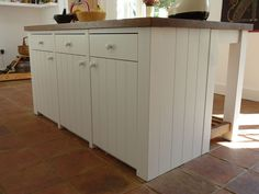 kitchen island in painted t and oak