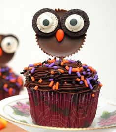 Owl Cupcake: What could be more appropriate for Halloween than an abundance of chocolate!? Inside BruCrew Life's Reese's owl cupcakes combine delicious chocolate cupcakes with Reese's Cups, mini Oreos, and even more candy. Source: Inside BruCrew Life