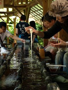 Nagashi somen, or flowing noodles, is an exciting summer time dining experience where bundles of noodles are sent down a bamboo trough filled with ice cold water. As the noodles flow by you catch them with your chopsticks and place them in your bowl of broth. #japan #noodles: