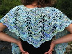 A delicate shawlette worked from the bottom up by building one row of motifs upon the next--while increasing the columns of motifs along the sides.