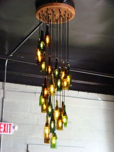 This Was A Custom 25 Light Wine Bottle Chandelier There Are Lights Hanging In Long Spiral The Ceiling Mount Is 2 Feet Cirference