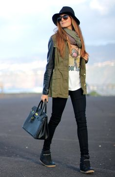 Love every single piece of this 'street style' outfit:graphic tee + black skinnies + military parka with leather sleeves + two-tone scarf + spiked accents on hat and high-top sneakers + black satchel + sunnies.Comfy and chic at the same time!