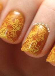 Fall-inspired layered stamping nail art