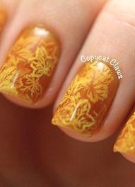 Fall-inspired layered stamping nail art
