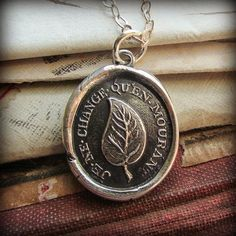 """What a beautiful statement - as a leaf changes its color in the autumn just before dropping to the ground ~ I Change Only In Death- this pendant pictures a symbolic Laurel Leaf with the French inscription """" Je ne change qu'en mourant"""" which translates to """" I do not change that by dying"""" or """"I change only in death"""". LIFE"""". This makes an endearing pendant for a best friend, mother, daughter, partner or spouse!"""