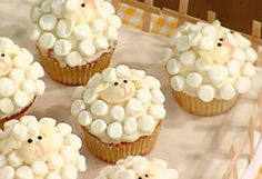 I love sheep! And there's a cake pan at Micheal's that makes cake into the shape of a sheep so these would go great with the big cake!