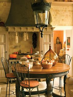 In this kitchen design from Barry Dixon Interiors, an antique street lamp from…