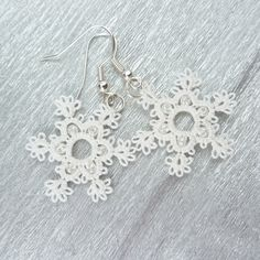 Snowflake earrings / white lace earrings / Winter fashion / snowflakes jewelry. £16.00, via Etsy.