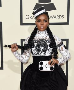 Janelle Monae in Christian Louboutin shoes and an Emm Kuo clutch