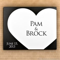 A customizable canvas wedding guest book. Customize the colors and inscription. Comes ready to hang.