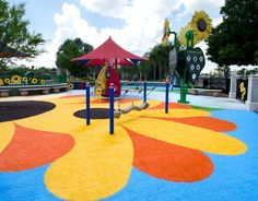 Who says grass has to be green? Not park developers for the City of Lakeland, Fl. The city recently opened a playground featuring multi-colored faux park grass. The orange, blue, and yellow grass not only looks incredible, but also provides a safety-rated surface for children that will last for years. The solution is a revolutionary park synthetic grass product called Playground Grass.