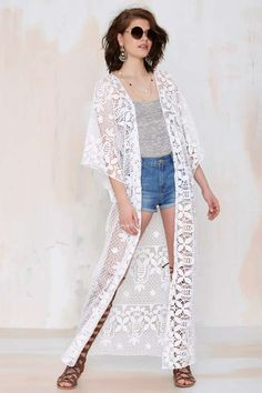 You're going to want to throw this white crochet kimono on over literally everything.