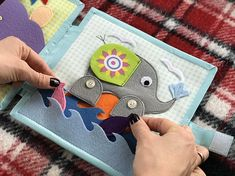 Childrens quiet book Elephant for toddlers. Recommended age: 2-5 years The quiet book is a good sensory toy for the kids helping to develop the fine motor and cognitive skills, form and color identification, behavior and mental logic, as well as imagination and to improve insistence and