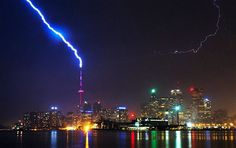 Lightning strikes the CN Tower during a thunderstorm in Toronto, Canada