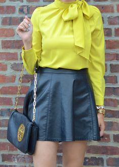 Faux leather skater skirt, bow blouse and Tory burch clutch for date night