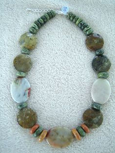 Handmade Mother Earth Stone Necklace by EtsyTopDrawerJewelry, $50.00.  So boho and hippie style.  Amazing design!
