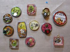 Lori Z Art Maniac -- May 07, 2010 - Resin Charms : ... my first adventure in resin. These charms are made from watch backs and various watch parts, charms, jewels, and buttons.