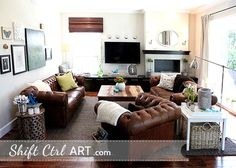 Love the glass tile fireplace and the leather sofa and chairs