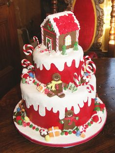 Christmas Cake with gingerbread house topper - this is a new idea. I like it - the red fondant probably tastes nasty; may be better made into a fake-cake for display only. plus, I don't eat cake. Christmas Cake Decorations, Christmas Sweets, Christmas Gingerbread, Holiday Cakes, Noel Christmas, Christmas Goodies, Holiday Treats, Christmas Baking, Christmas Cakes