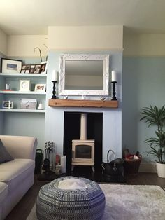 Cream log burner & floating beam mantle! Duck egg & cream room