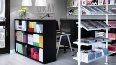 Bookshelves backed by desks instead of cubicles. Office space hidden behind GALANT shelving units
