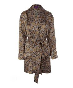 Liberty London short silk kimono. This lightweight short summer dressing gown, is made from a soft cotton voile, it features a stunning floral Indiana print, slim-line sleeves, a wide belt with loops, gathered detail pockets and a pompom style lace trim.
