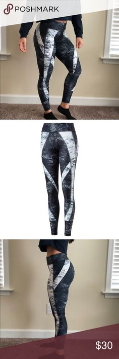 Puma Explosive Tights Workout leggings by puma. Form fitting, but not restrictive. Fun design! Only worn once Puma Pants Leggings